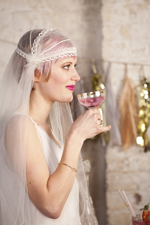 Bride about to take sip of drink