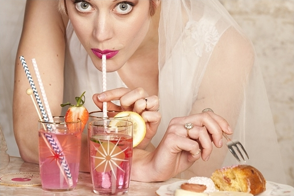 Bride drinking through straw
