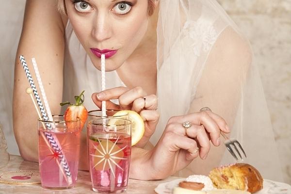 Bride drinking through straw
