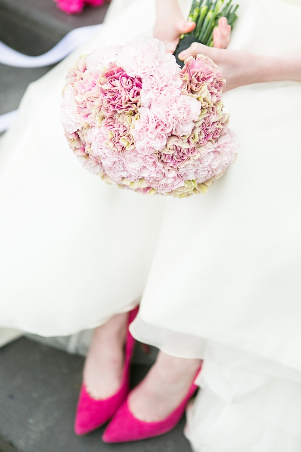 Bouquet and bride's pink shoes