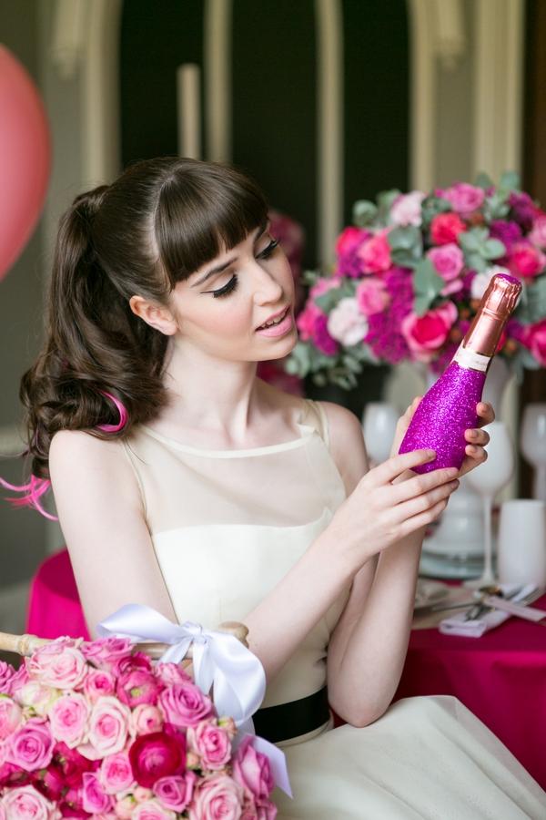 Bride looking at purple bottle
