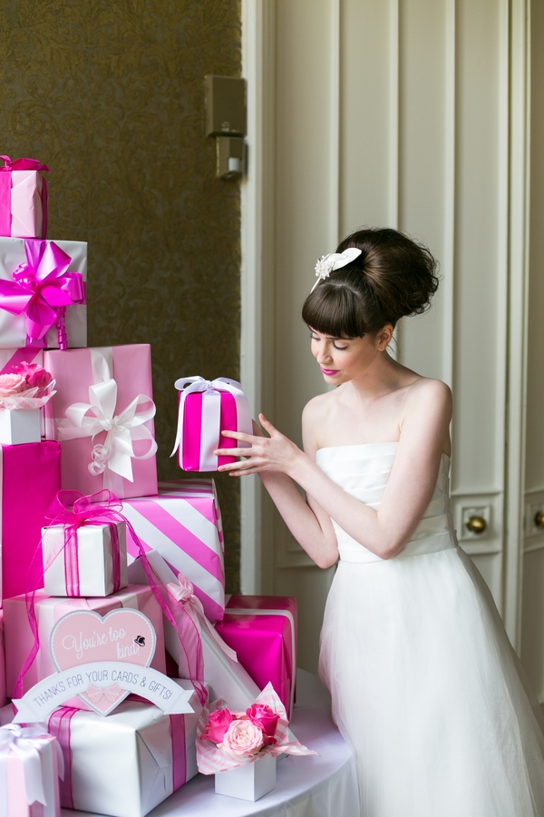 Bride placing present on pile