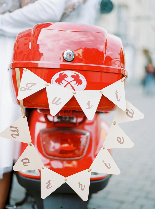 Bunting on back of red Vespa