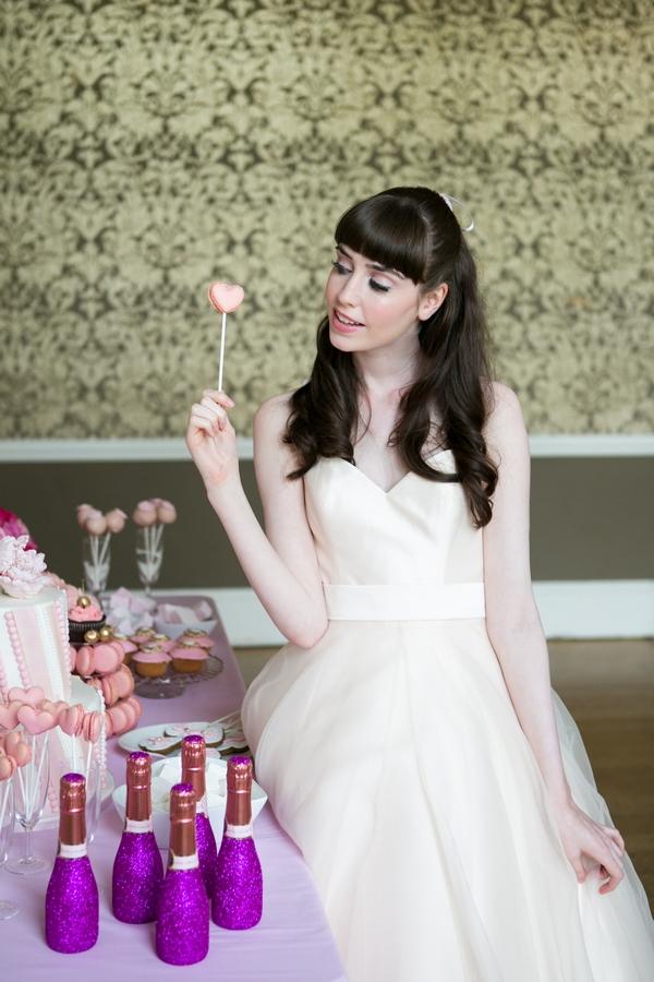 Bride holding cake on stick