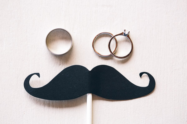 Wedding rings and moustache on stick