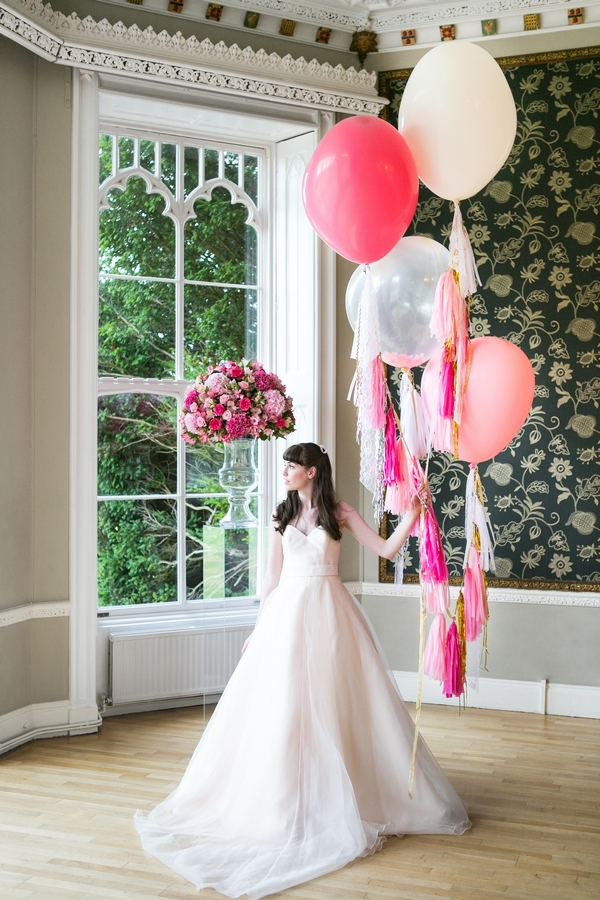 Bride holding balloons