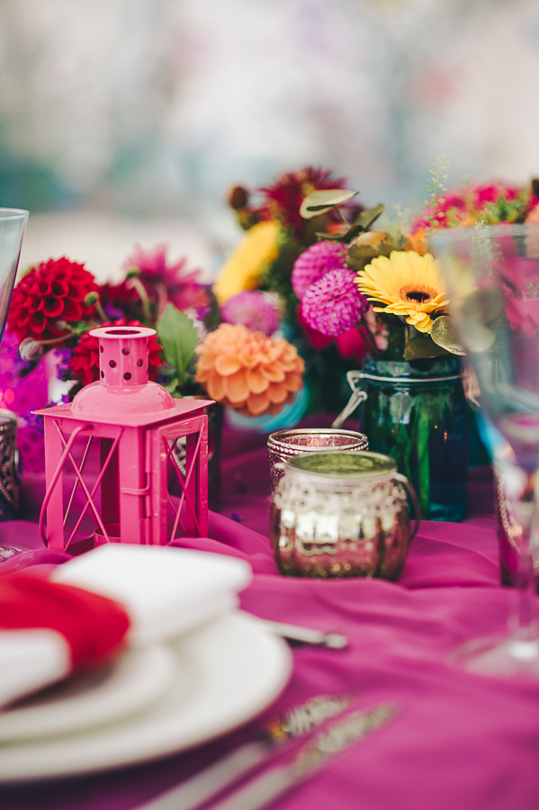 Brightly coloured wedding table flowers and accessories