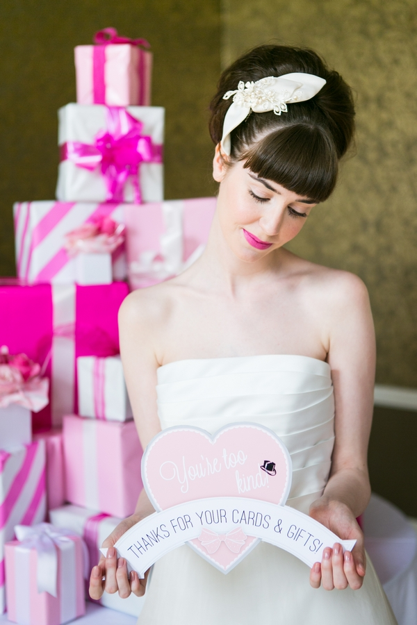 Bride holding heart sign