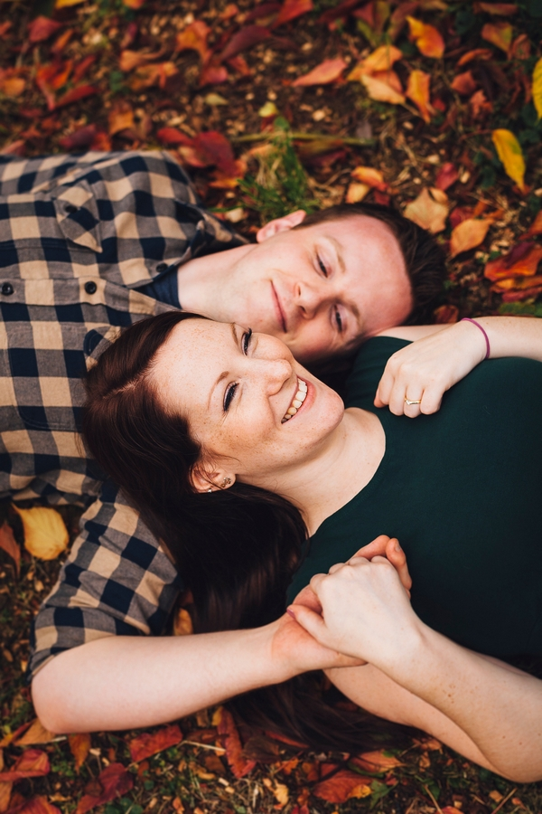 Couple laying together on leaves