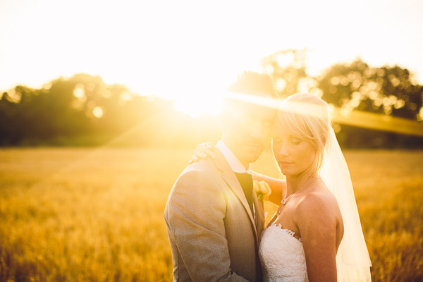 Bride and groom in hazy sunshine