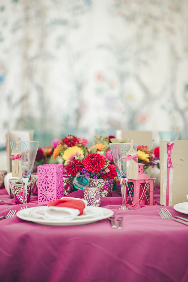 Wedding table dressed with bright accessories