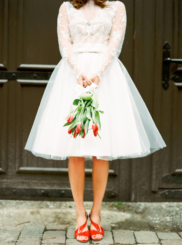 Bride holding red tulips