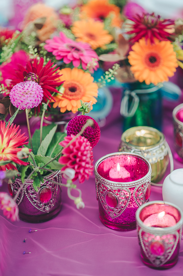Votives and bright flowers