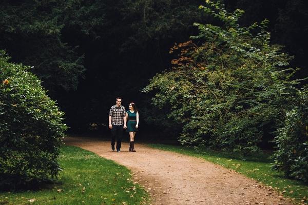 Couple walking through Westonbirt Arboretum