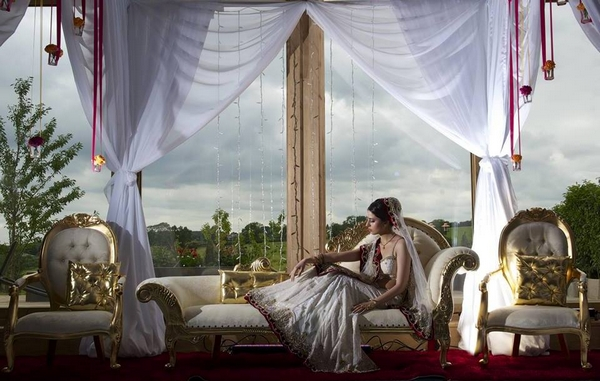 Inidan bride on chaise longue - More Weddings