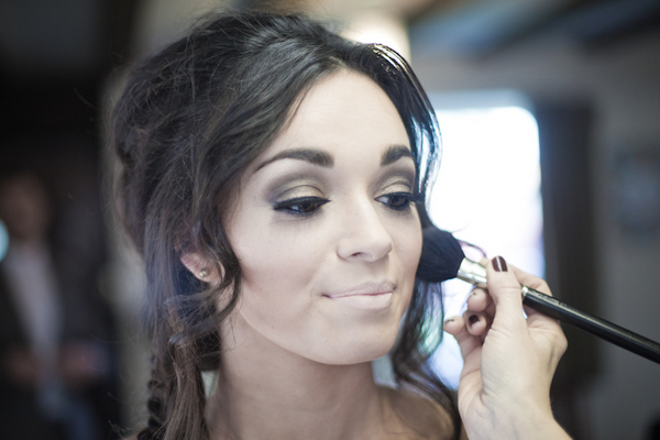 Bride having make-up applied