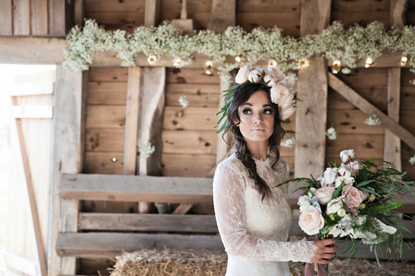 Bride with large floral headpiece holding bouquet