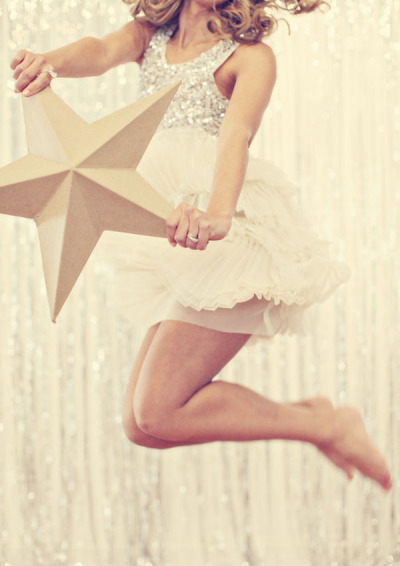 Bride holding star and jumping