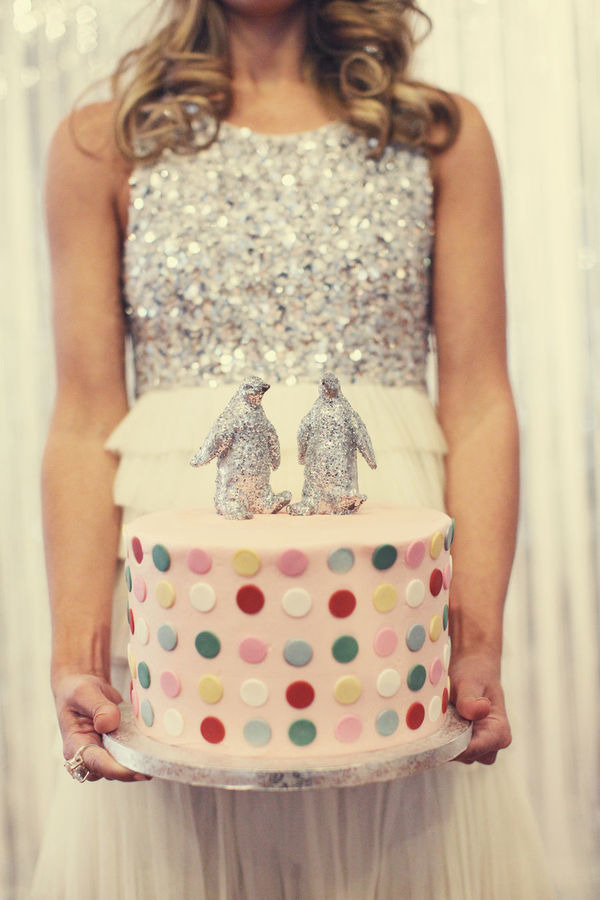 Bride holding spotty wedding cake