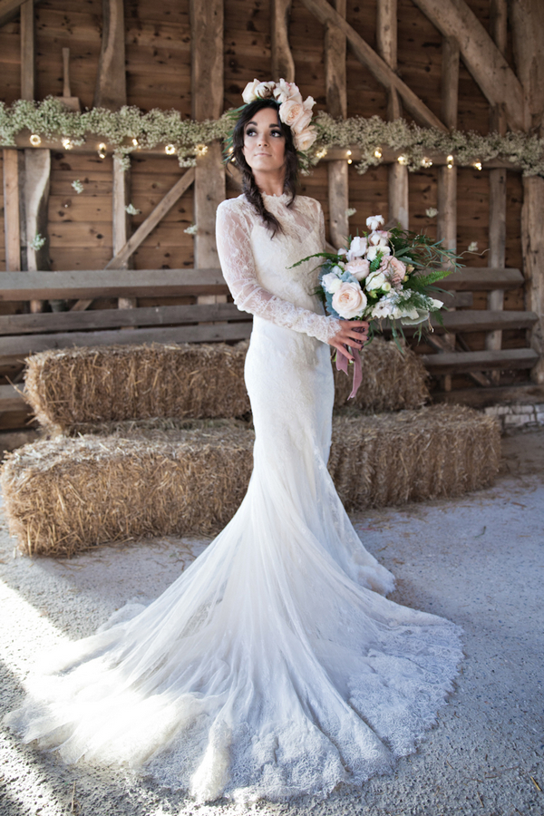 Bride holding bouquet in barn