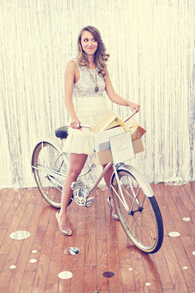 Bride on silver bicycle