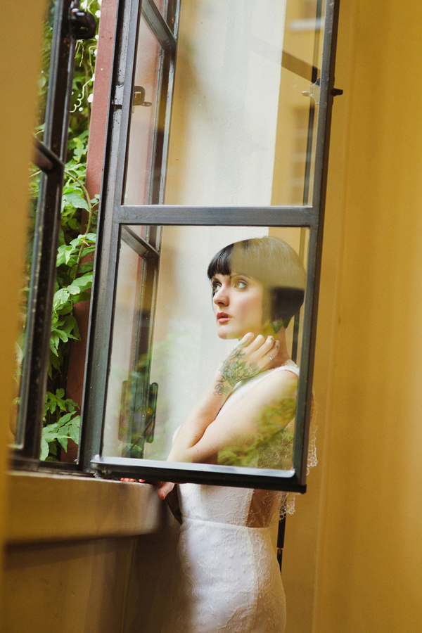 Bride with bob looking out of window