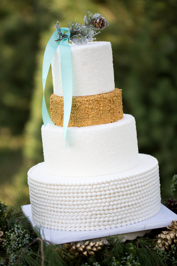 Gold and white tiered wedding cake