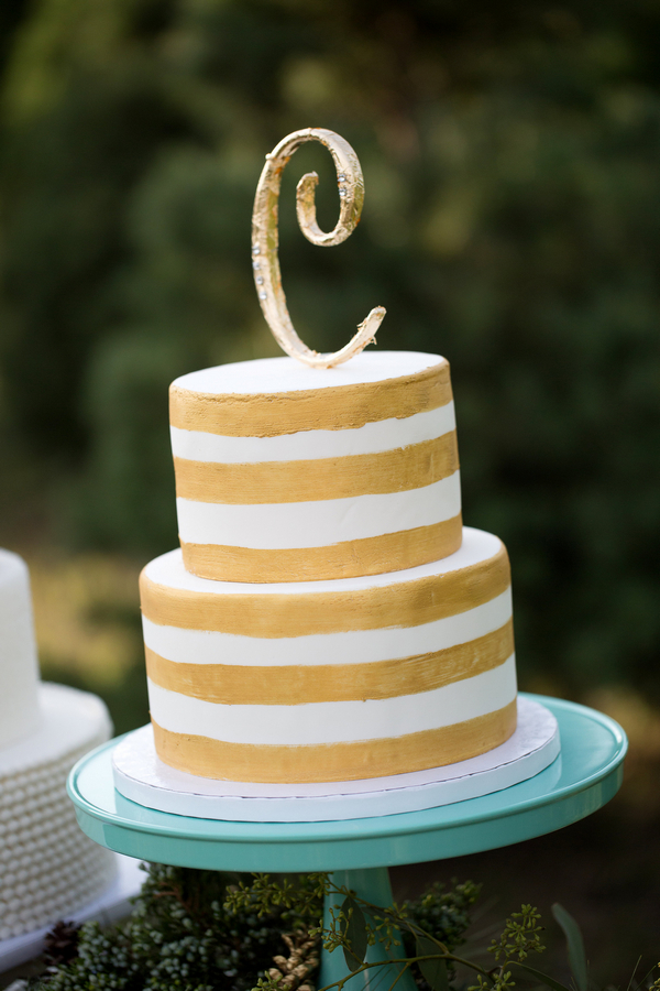 Gold and white striped wedding cake