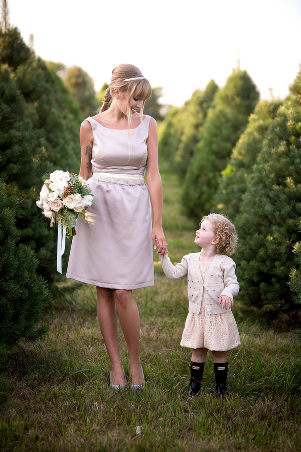 Bridesmaid and flower girl holding hands