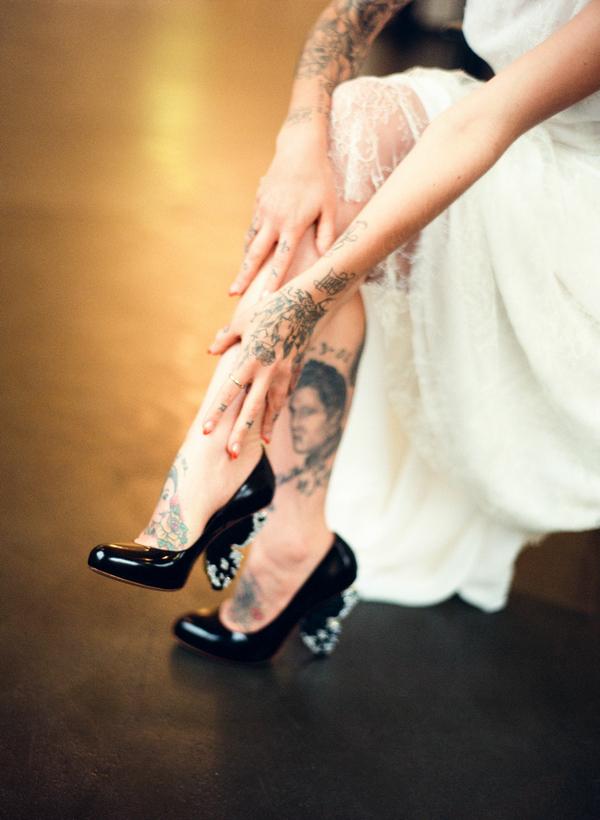 Tattoos on bride's legs