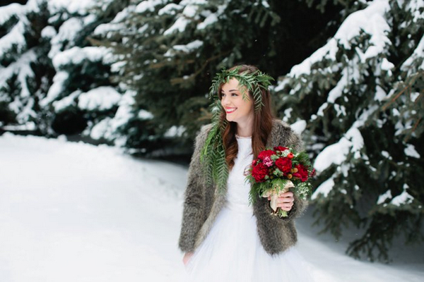 Bride holding bouquet in snow