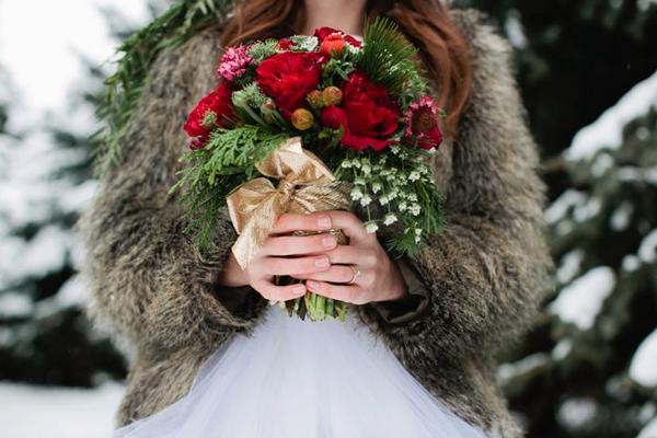 Bride holding Christmas wedding bouquet