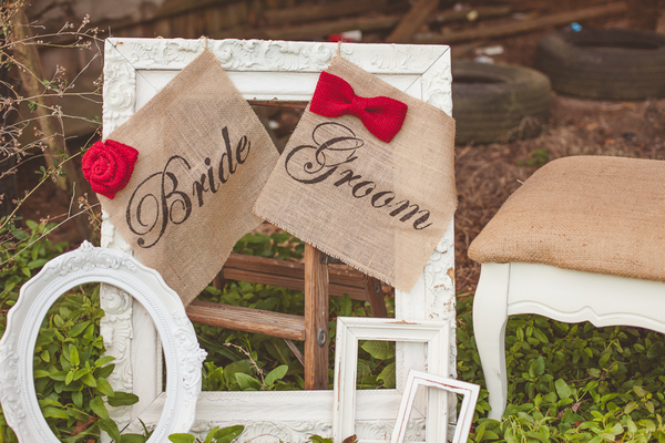 Bride and groom signs on picture frames
