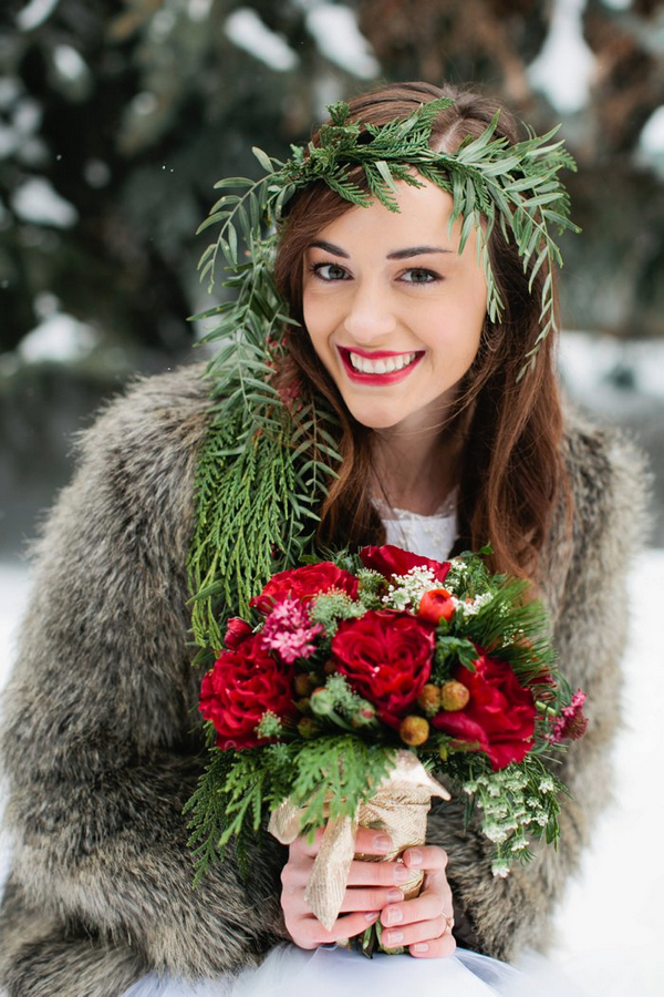Bride with leaf headpiece holding Christmas wedding bouquet