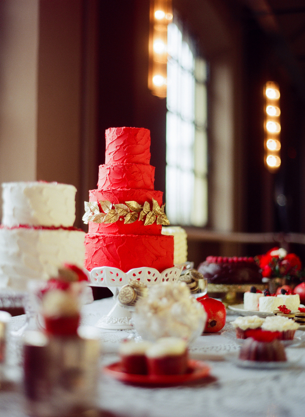 Red wedding cake with gold leaf detail
