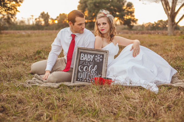 Bride and groom sitting on grass