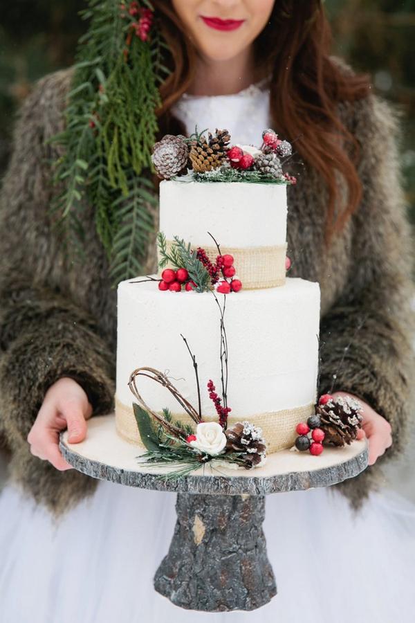 Bride holding Christmas wedding cake