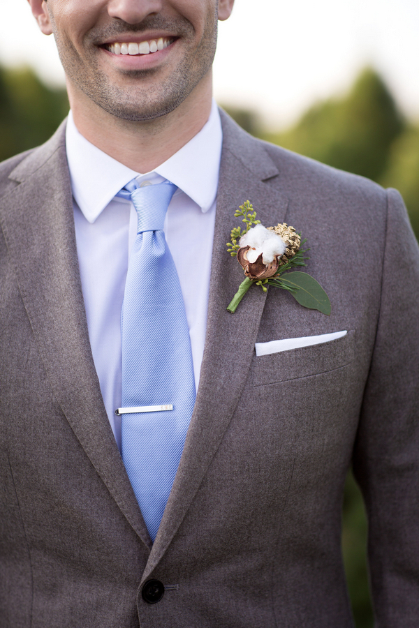 Groom's blue tie and buttonhole