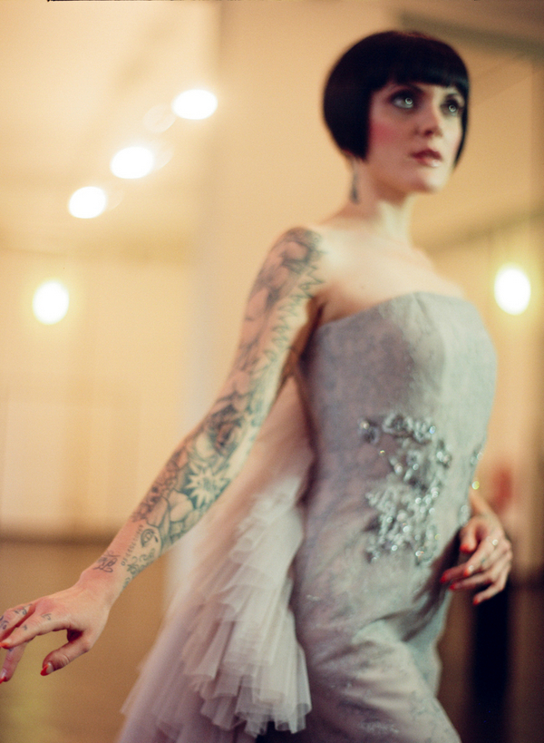Bride with bob and tattoos wearing silver wedding dress