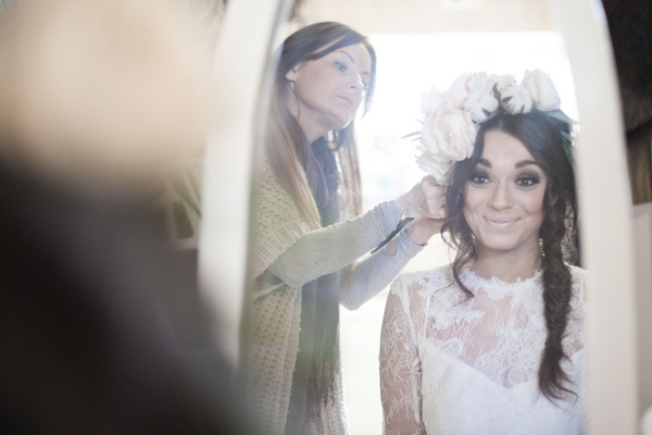 Bride putting on large floral headpiece