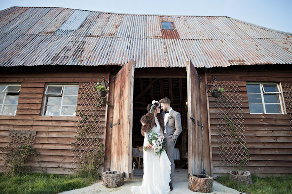 Bride and groom outside Horseshoes Barn, The House Meadow