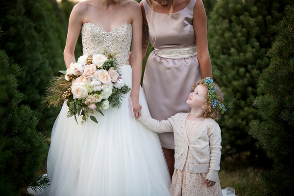 Flower girl looking up at bride