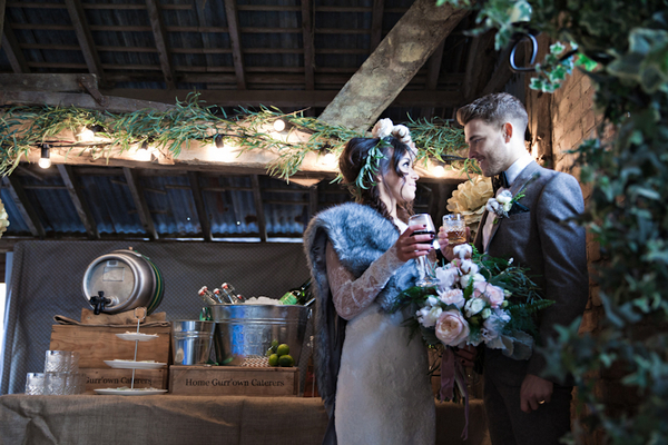 Bride and groom having drinks