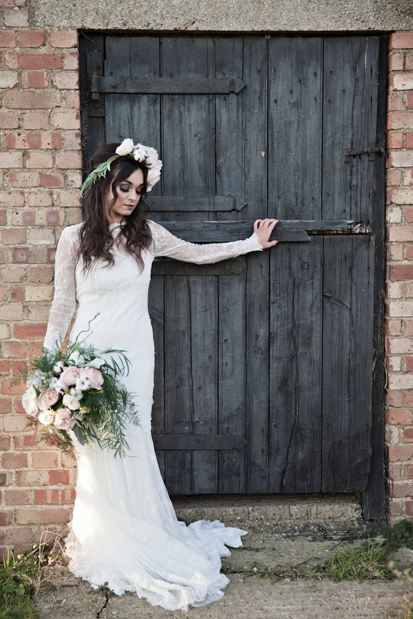 Bride leaning on barn door