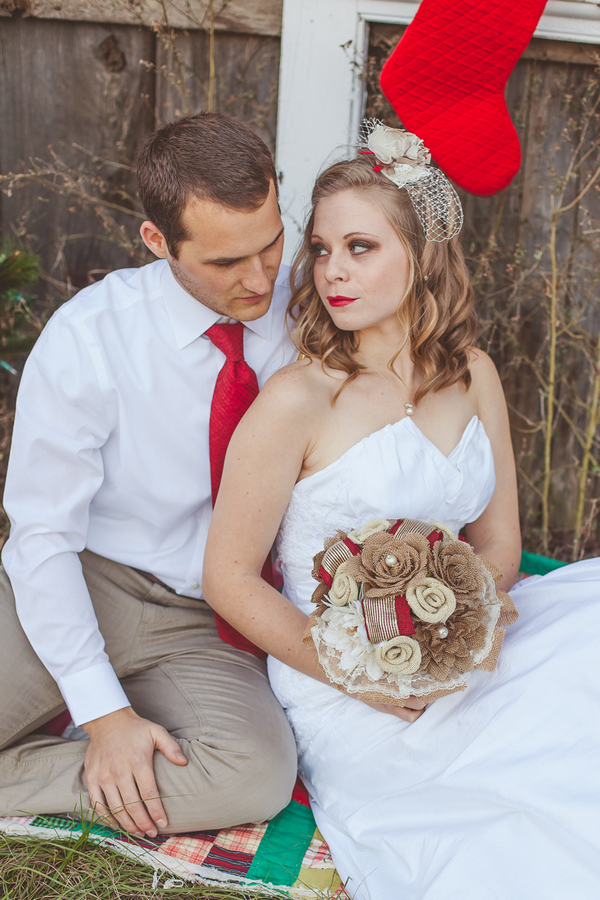 Groom sitting with bride holding bouquet