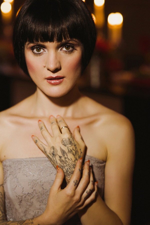 Bride with bob hairstyle and hand tattoo