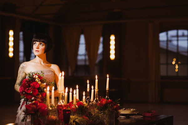Bride sitting next to candles
