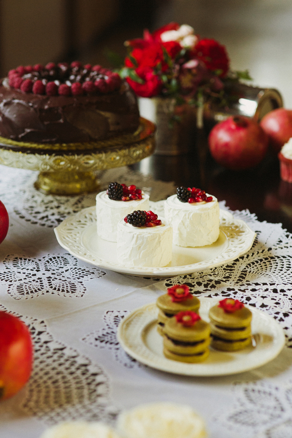 Small white cakes with red berries