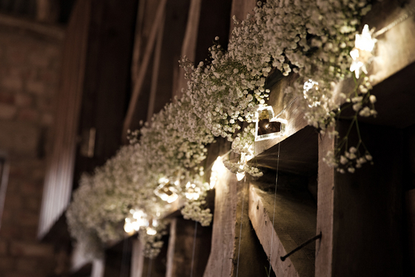 White flowers across barn beam