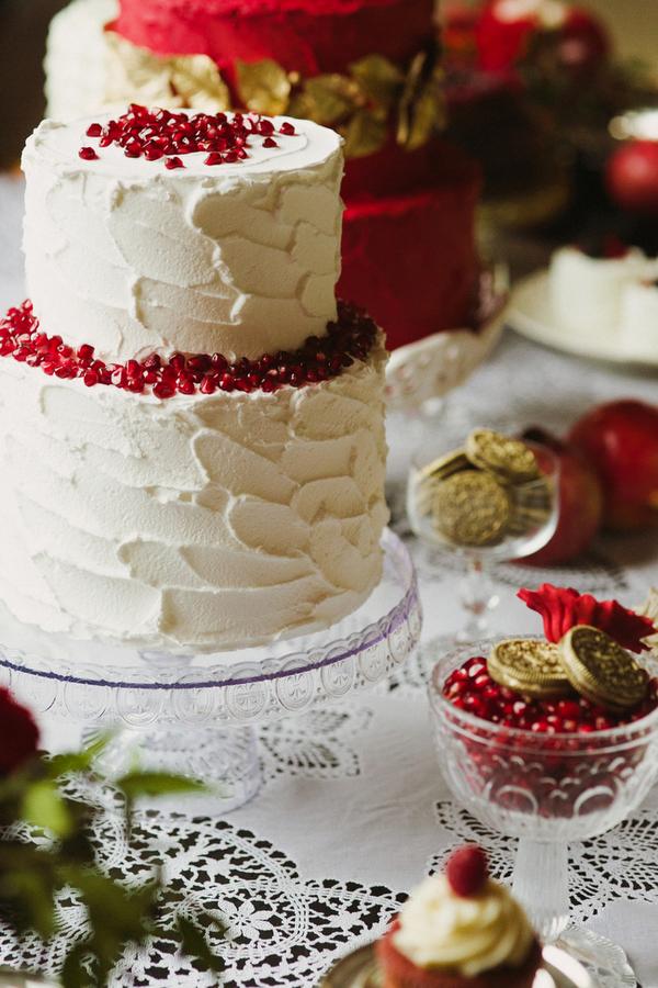 White wedding cake with pomegranate